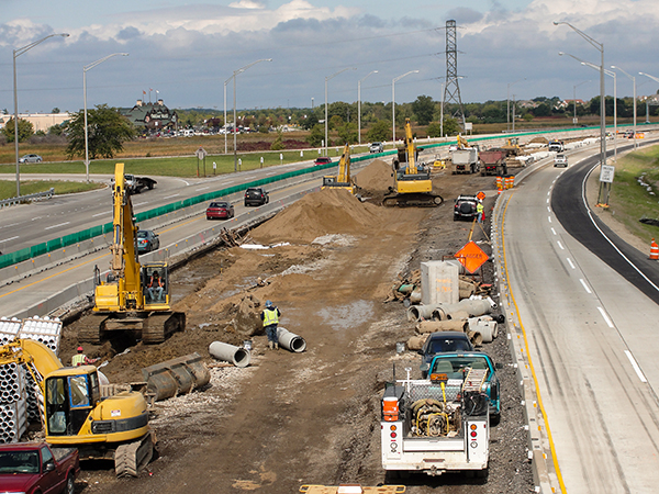 Construction Equipment opening lanes on interstate.