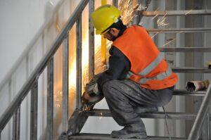 Welder on staircase