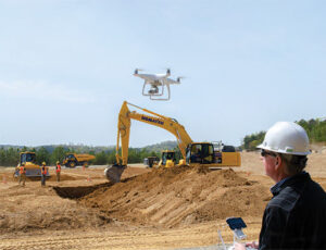 Drone flying over excavator